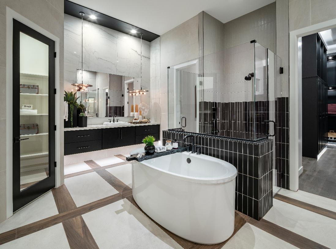 Gorgeous primary bathroom with walk-in shower and freestanding tub