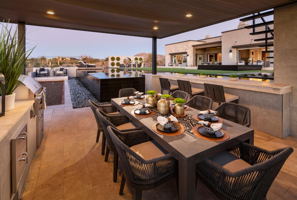 Resort-style backyard with pool, outdoor kitchen, bocce ball, and more