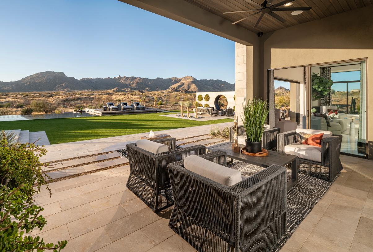 Oversized cover patio that overlooks the resort-style backyard