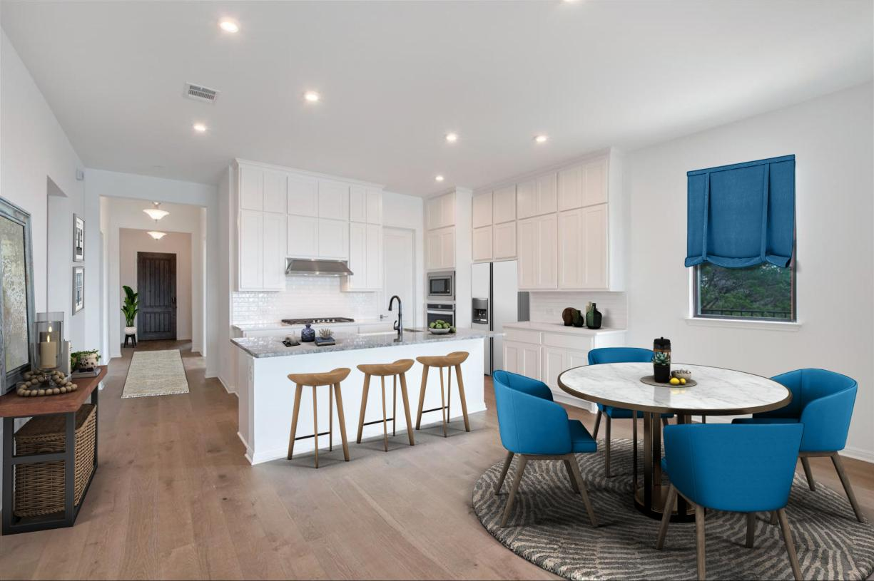 Well-designed kitchen overlooks a spacious casual dining area
