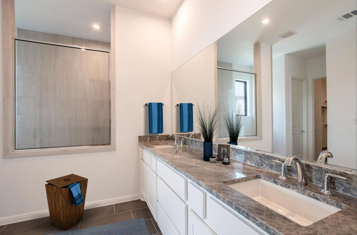 Spa-like primary bath with dual-sink vanity, large luxe glass-enclosed shower