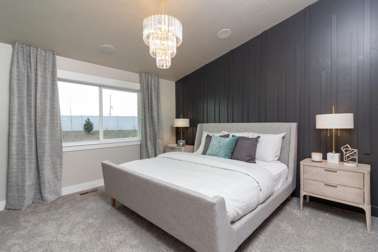 Inviting primary suite offers ample room to relax