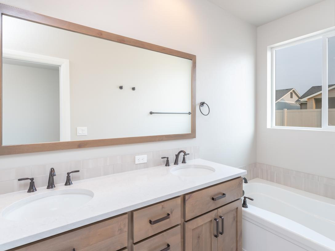 Double sinks in primary bathroom with separate tub