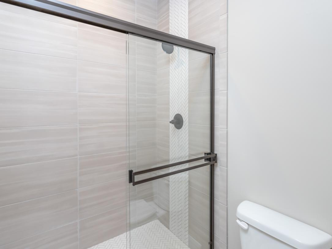 Beautifully tiled walk-in shower at primary