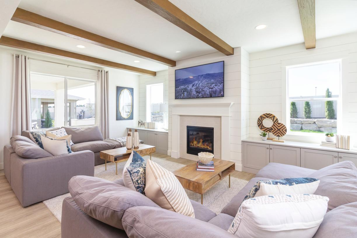 Open concept great room accented by a striking fireplace
