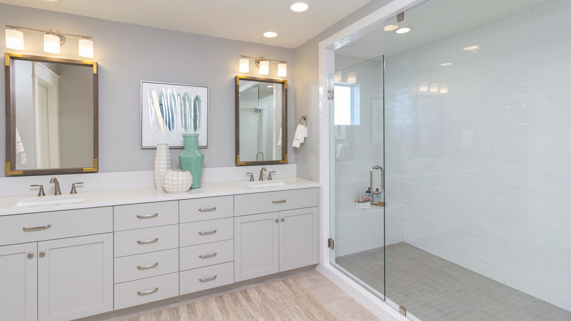 Primary bath with dual-sink vanity and deluxe walk-in shower