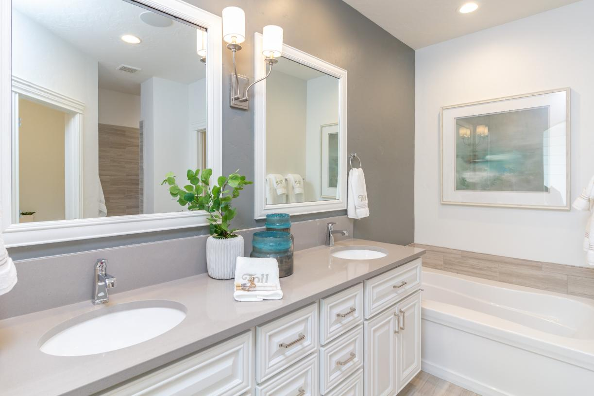 Primary bath with dual-sink vanity and relaxing soaker tub