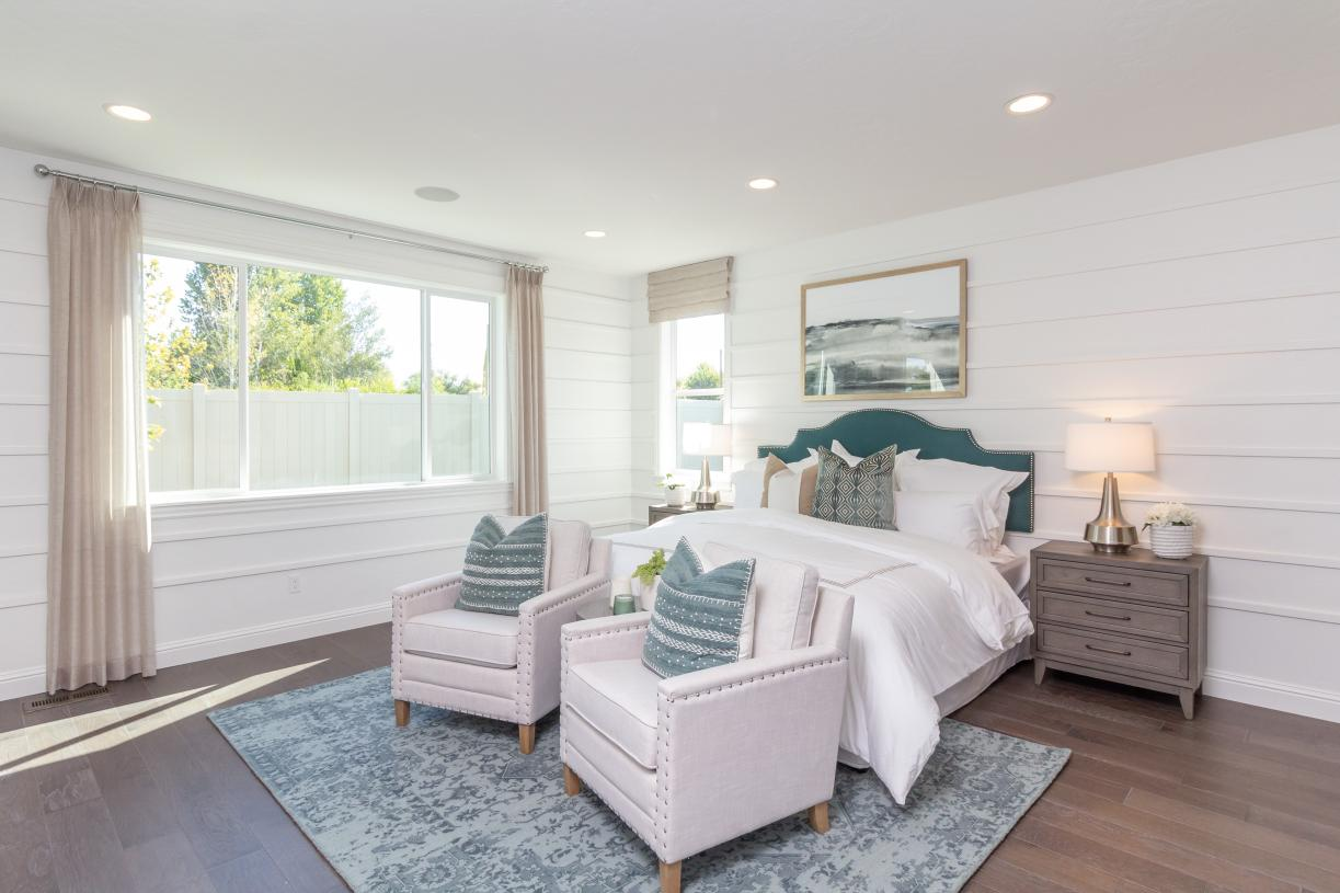Restful primary suite with abundant natural light