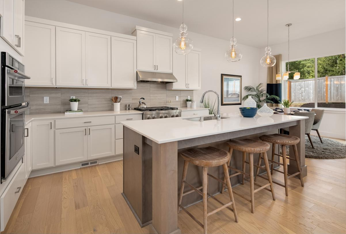 Well-designed kitchen with center island and adjacent dining area