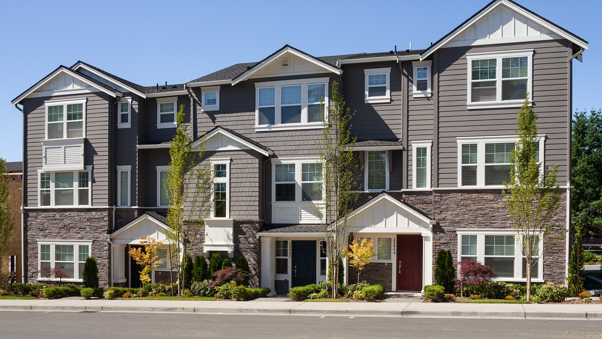 Classic architecture of the Dahlia and Delridge townhomes