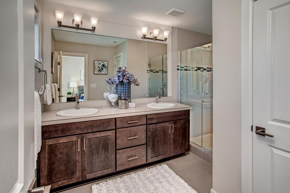 Luxe primary bath with a dual sink vanity
