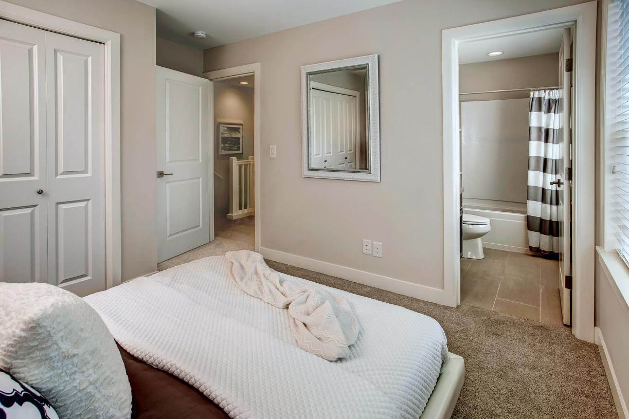 Secondary bedroom with private en-suite bath
