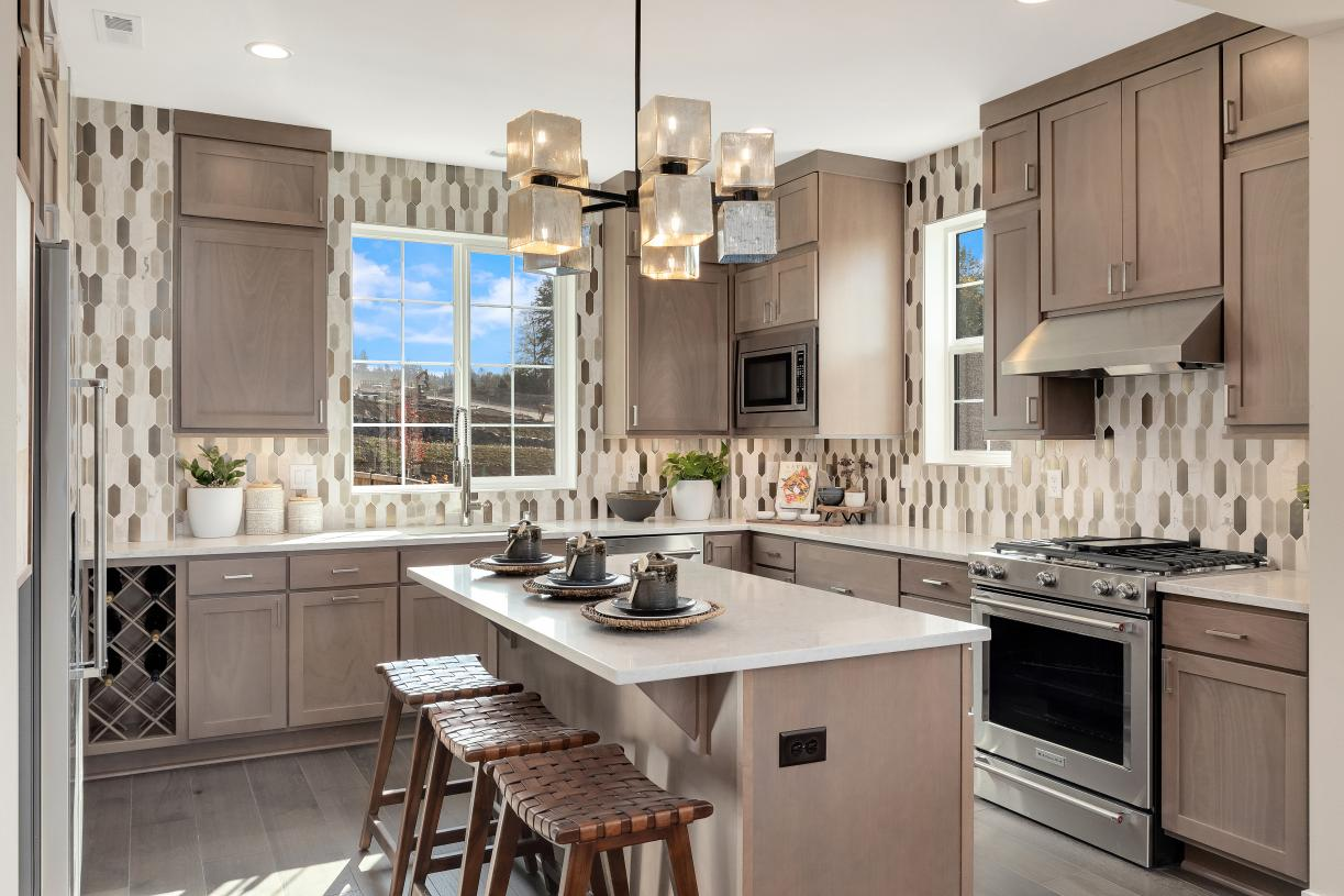 Well designed kitchen with island seating for three