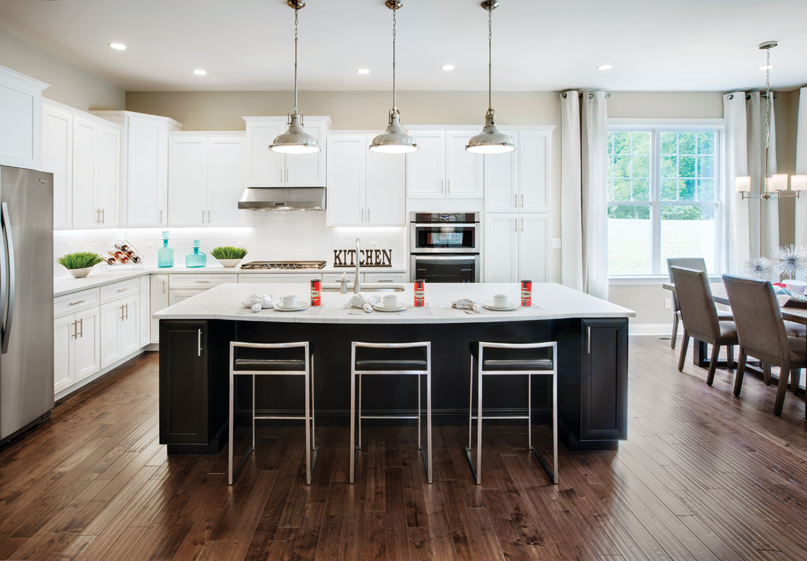 Spacious kitchens with granite countertops and Century cabinetry