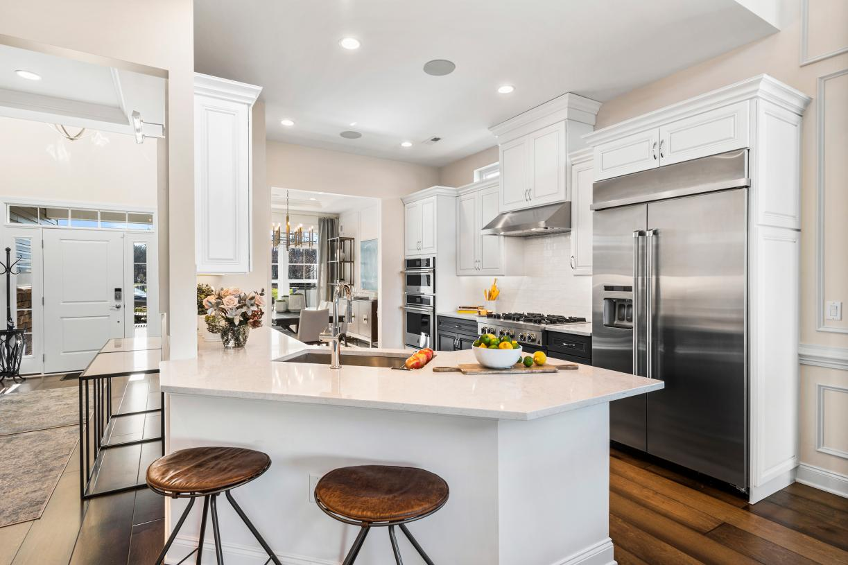 The centrally located kitchen is the heart of the home