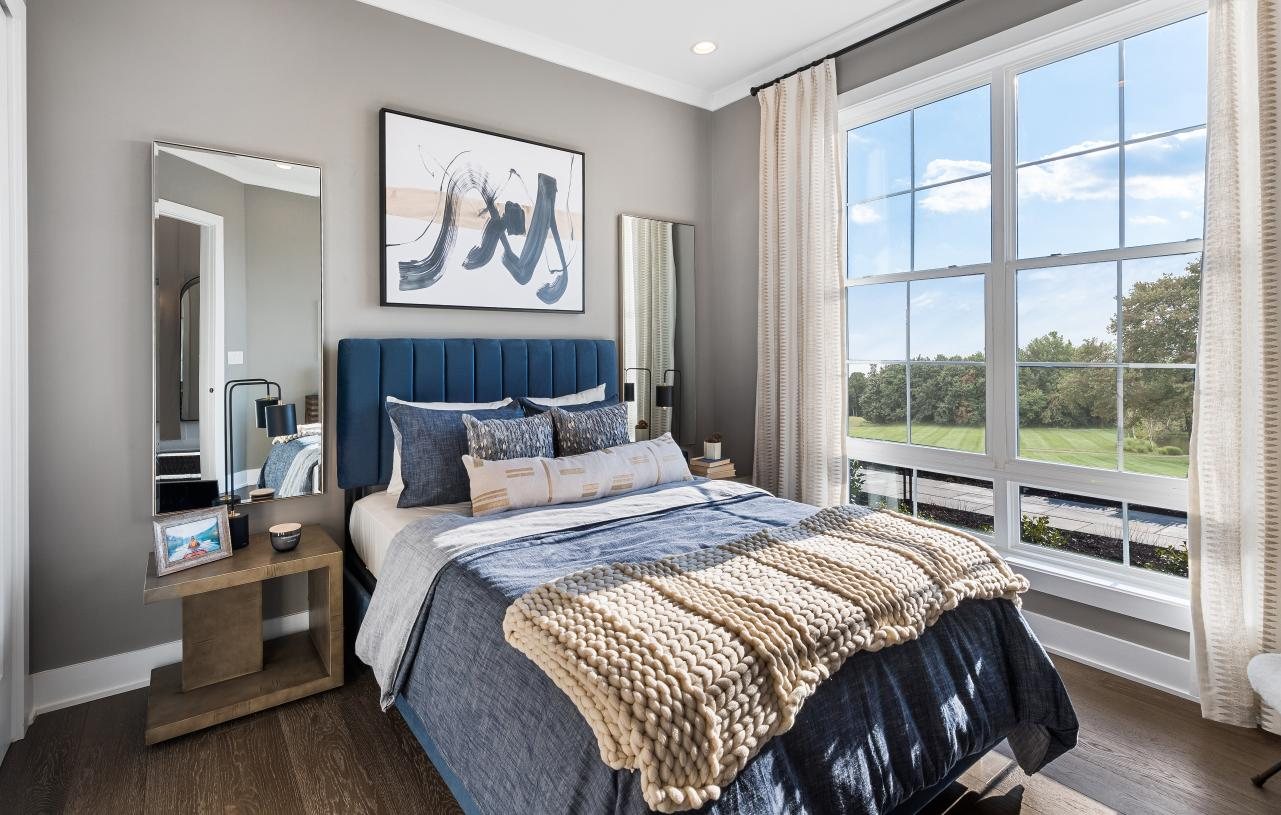 Privately located guest bedroom with bathroom