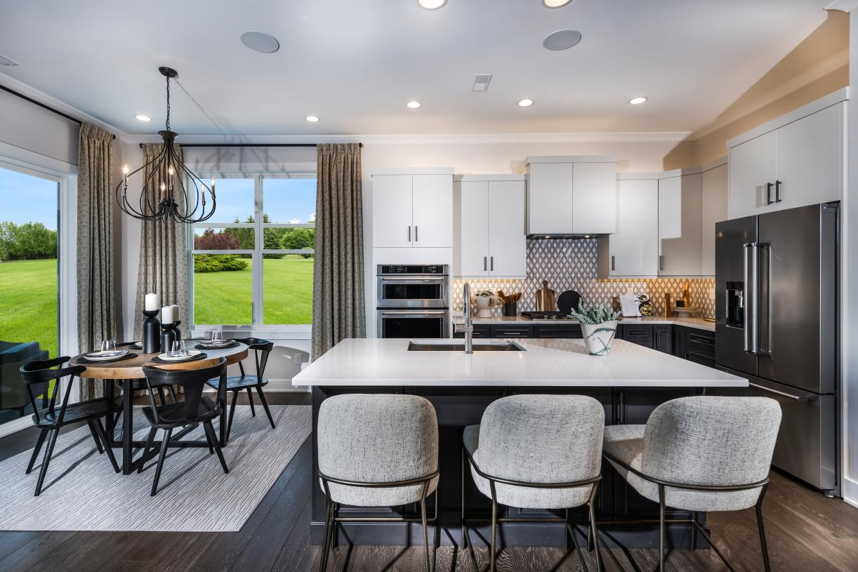 Well-appointed kitchen overlooks casual dining area