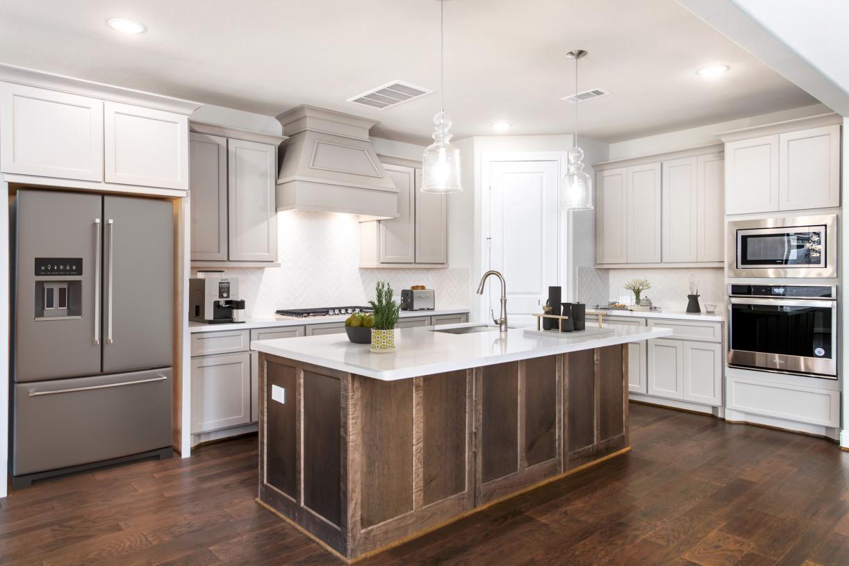 Gourmet kitchen revolves around a large center island
