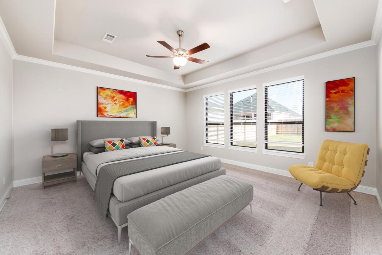 First floor primary bedroom suite features dual walk-in closets