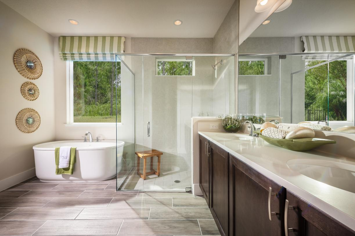 Spa-inspired primary bathrooms