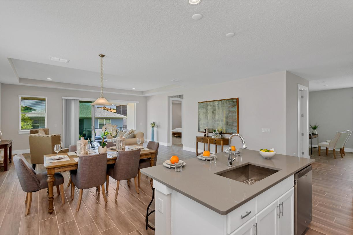 Kitchen overlooking casual dining and great room