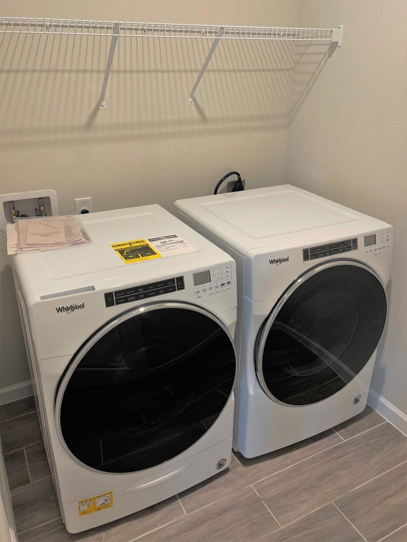Laundry with Whirlpool washer and dryer