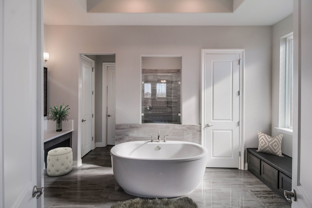 Relax in the resort-style Newcastle primary bath