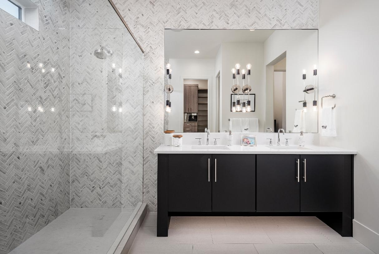 Lavish primary bathrooms with large walk-in showers