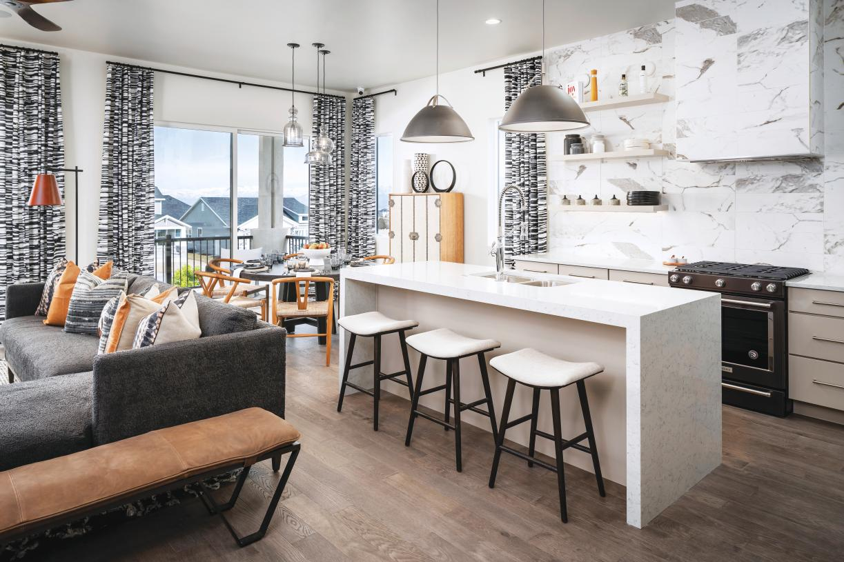 Beautiful kitchen with island breakfast bar and casual dining area adjacent