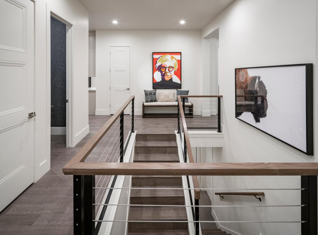 Wide hallway with access to the basement