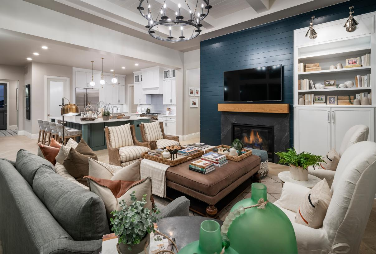 Cozy great rooms with fireplaces and views of the kitchen beyond