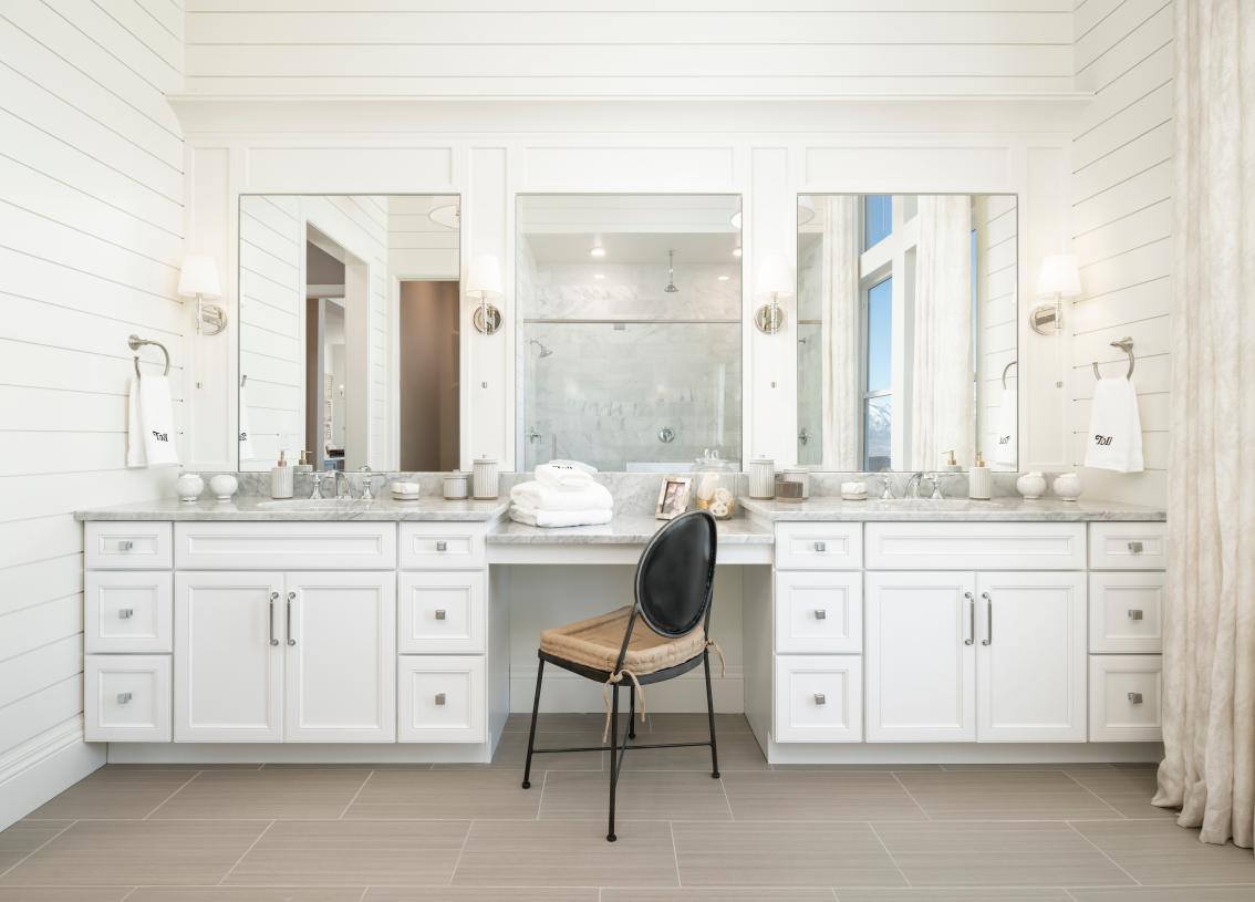 Lavish primary bathroom with dual-sink vanity and large soaking tub options