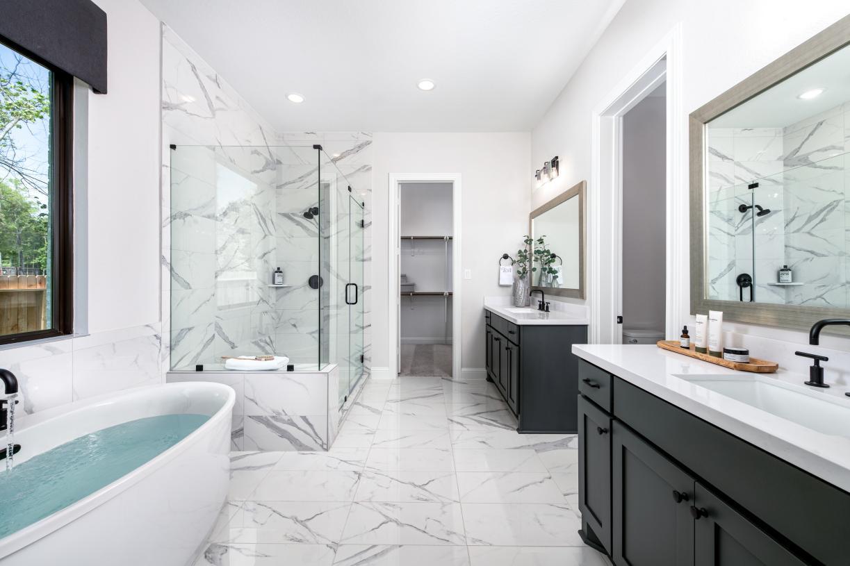 Watson primary bathroom with freestanding tub and dual vanity