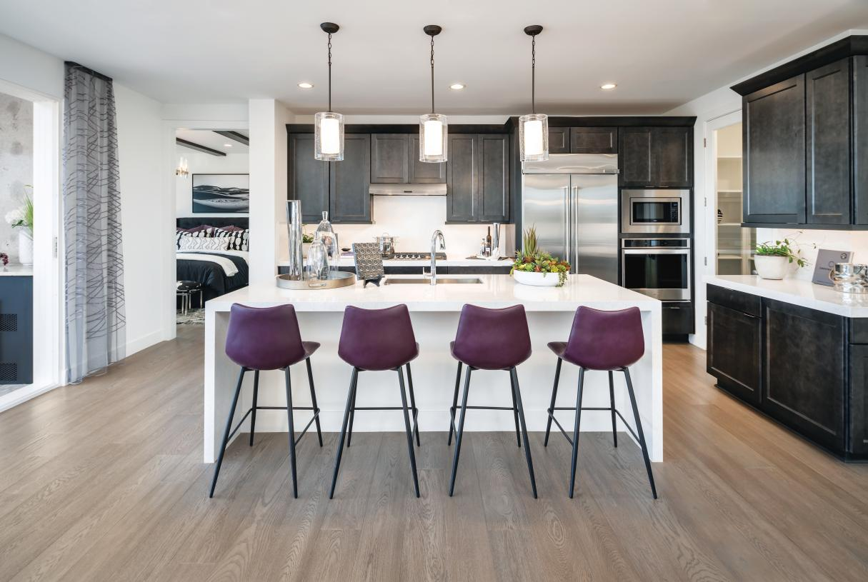 Well-appointed kitchens with premium stainless steel appliances
