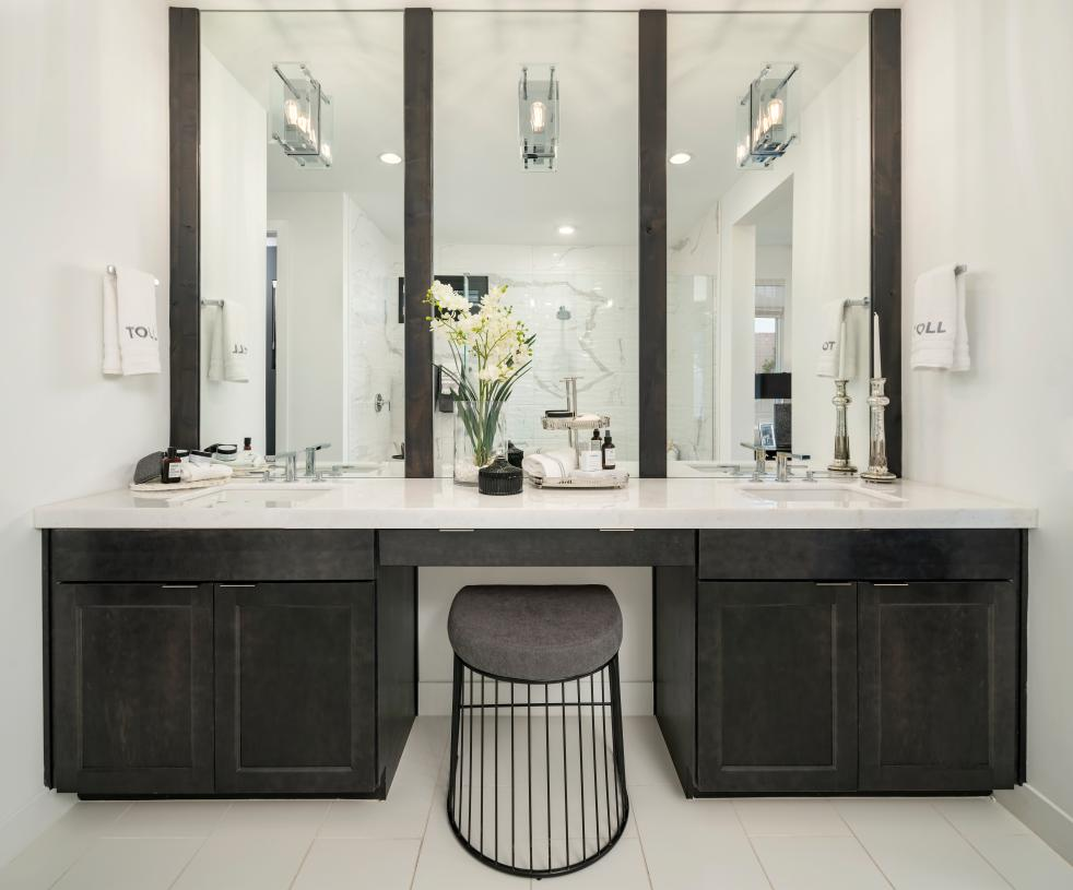 Luxurious primary bathrooms feature dual-sink vanities and large walk-in showers