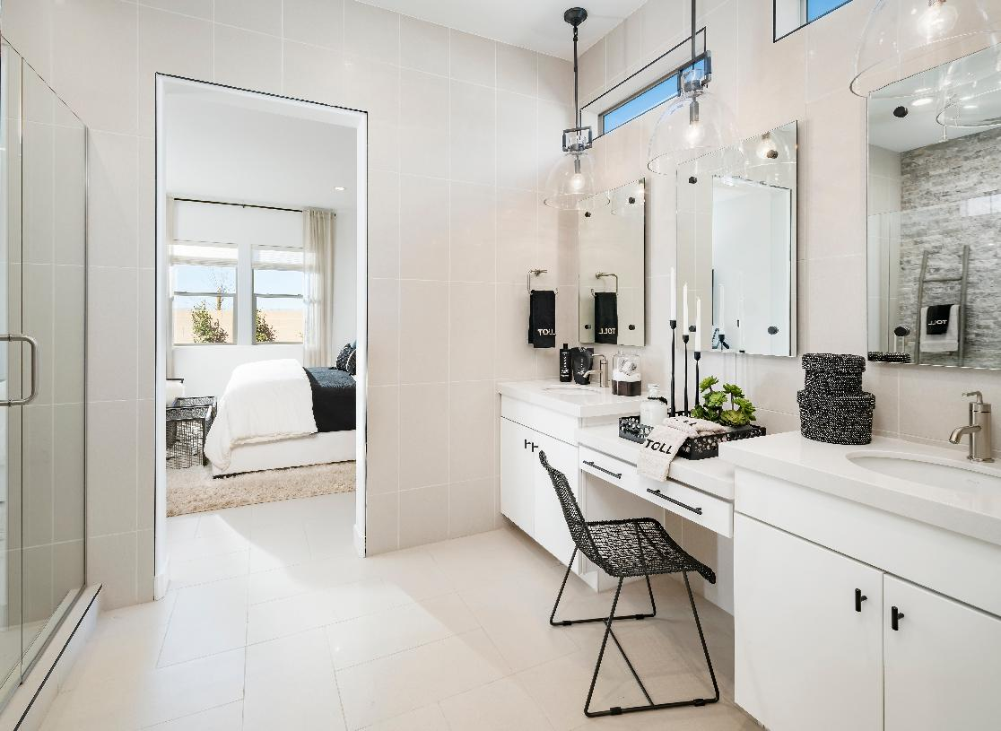 Luxurious primary bathrooms with dual-sink vanities and large walk-in showers