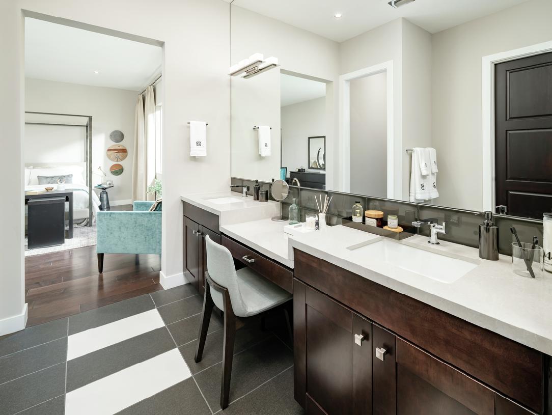 Spa-like primary bathroom with dual vanities