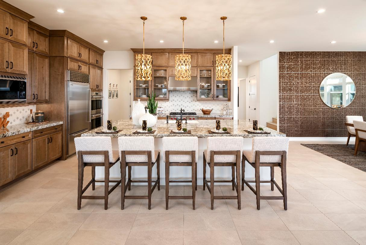 Well-appointed kitchens feature large center islands and stainless steel appliances