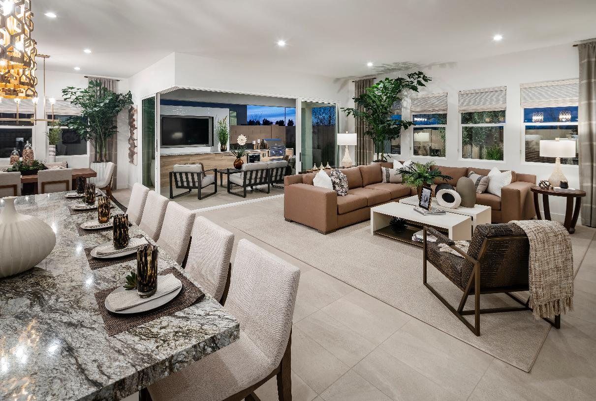 Open concept kitchen, dining, and great room with 90-degree multi-slide door
