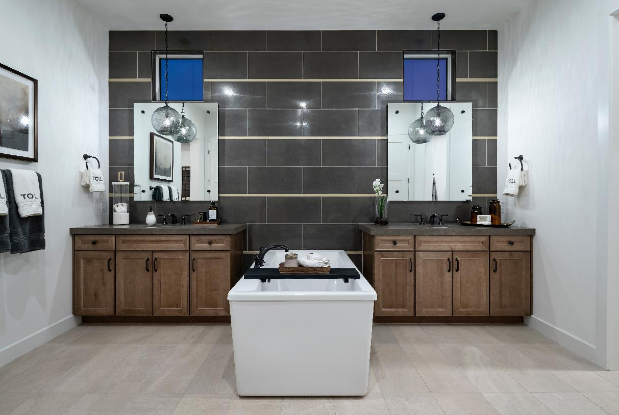 Primary bathroom with dual vanities and large soaking tub
