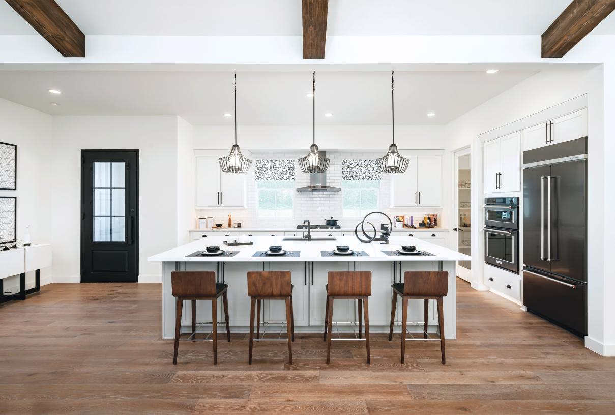 Well-designed kitchens with large center islands and roomy walk-in pantries