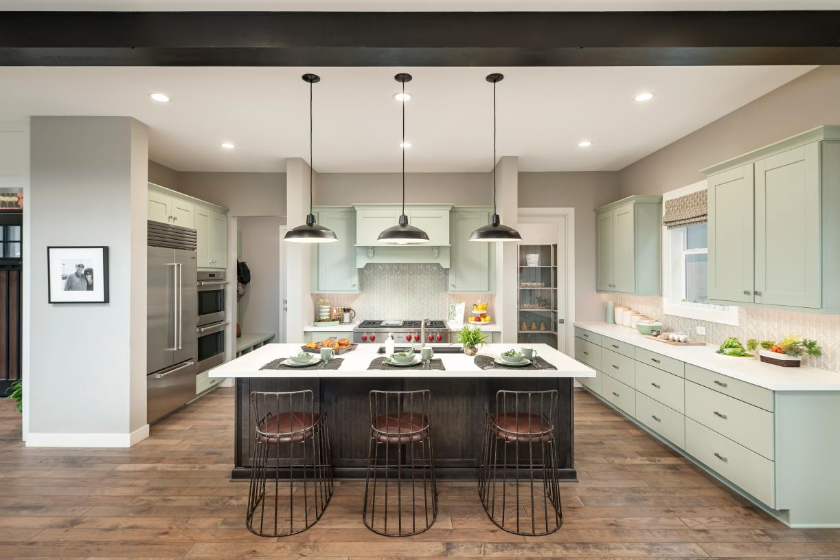 Well-appointed kitchens feature large center islands, plenty of cabinet and counterspace, and roomy walk-in pantries