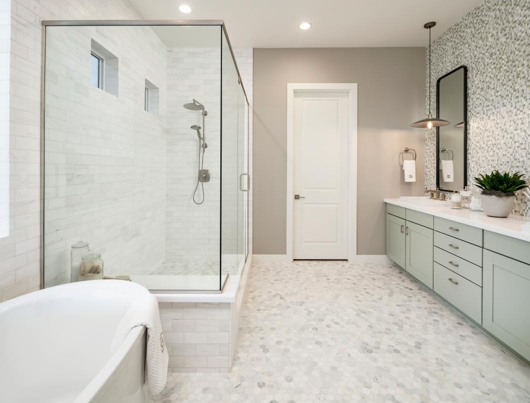 Spa-like primary bathrooms with dual-sink vanities and impressive walk-in showers