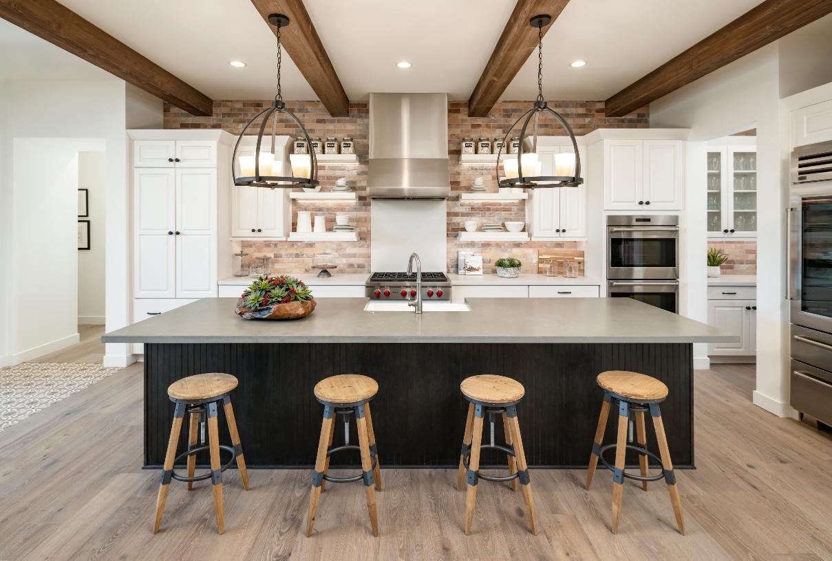 Well-designed kitchen with large center island and breakfast bar