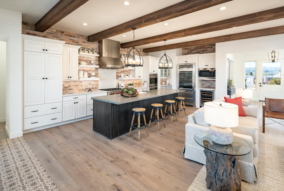 Kitchen with large center island, plenty of counter space, and walk-in pantry