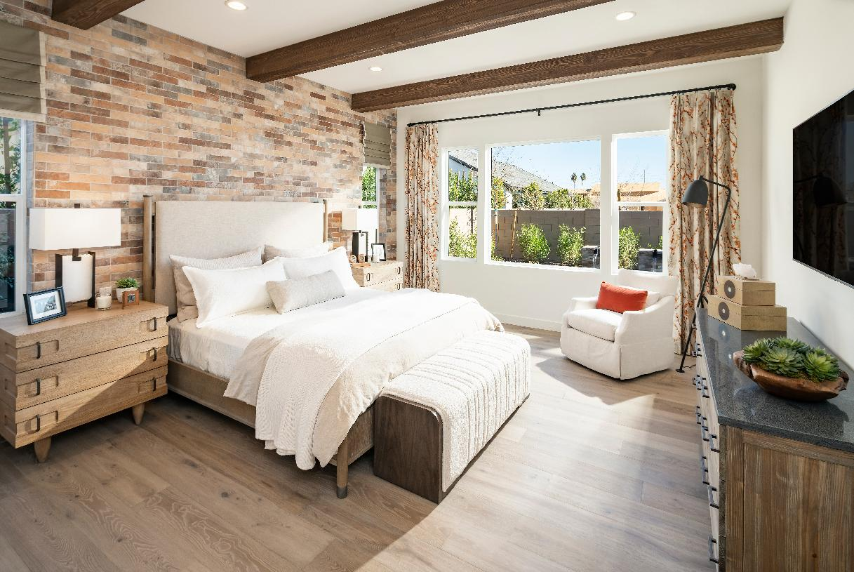 Stunning primary suite with wood beams at ceiling