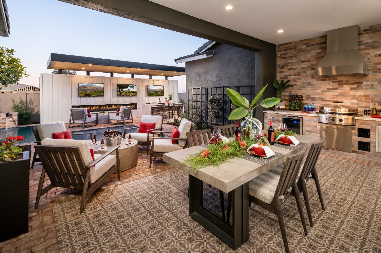 Resort-style backyard with outdoor kitchen and pool