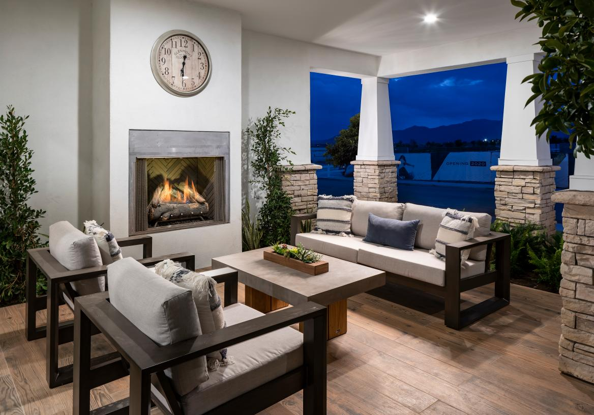 Charming covered patio with fireplace