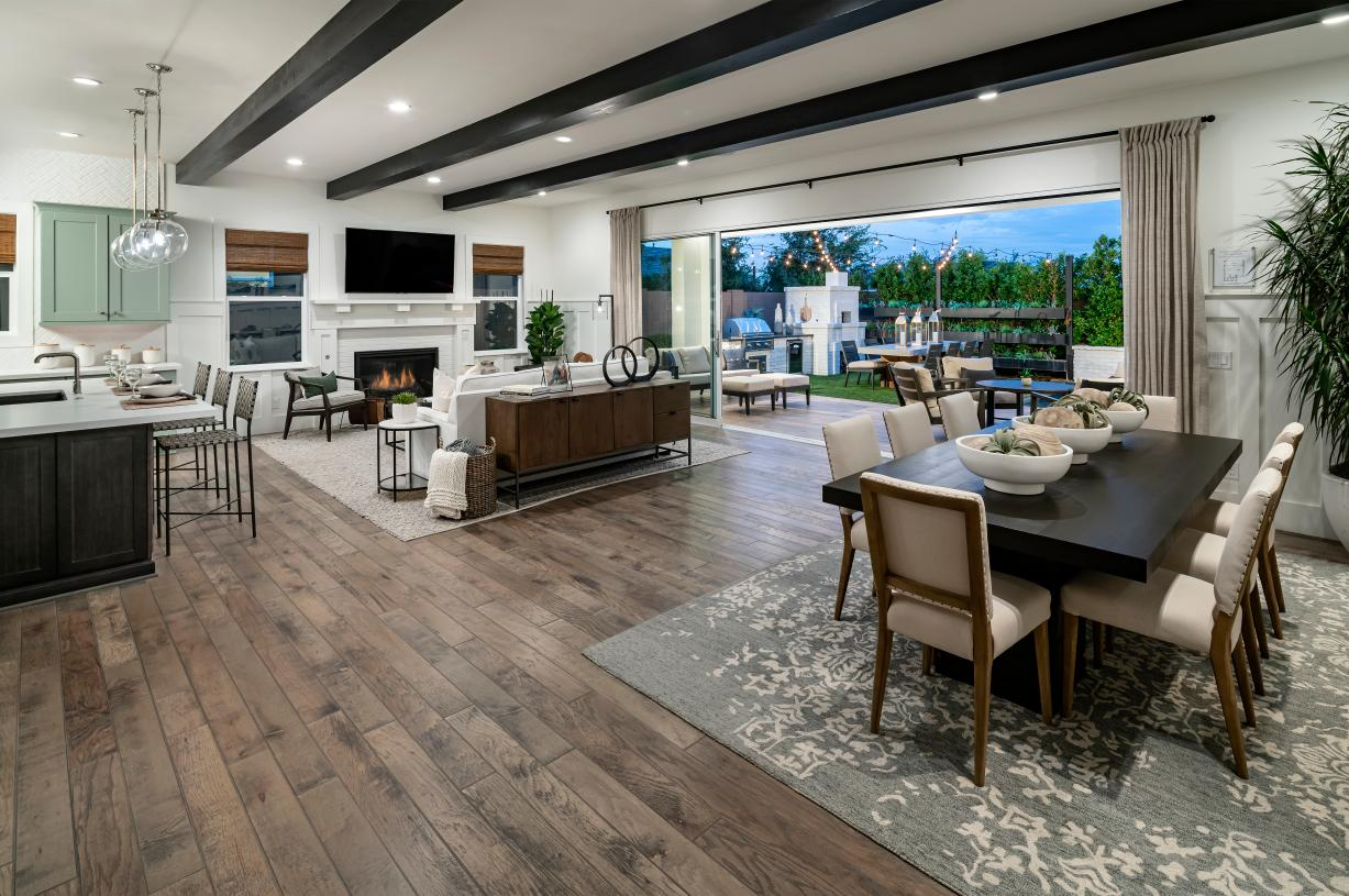 Open kitchen, dining, and great room with expansive multi-slide door