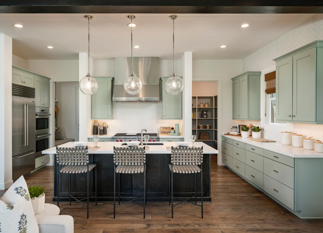 Gourmet kitchen with large center island and upgraded cabinetry, countertops, and backsplash